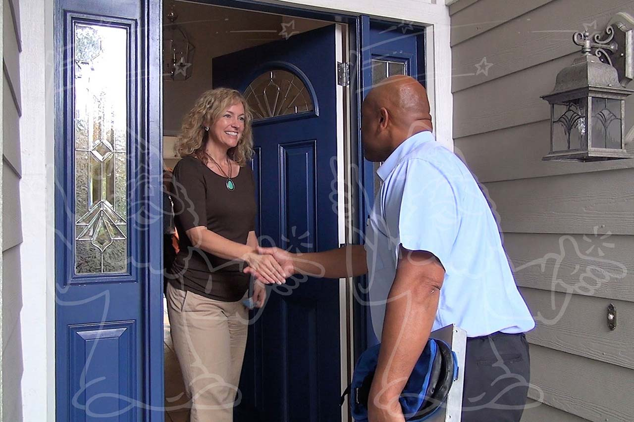 Carpet Cleaner Greeting Customer at the Door Photo Example