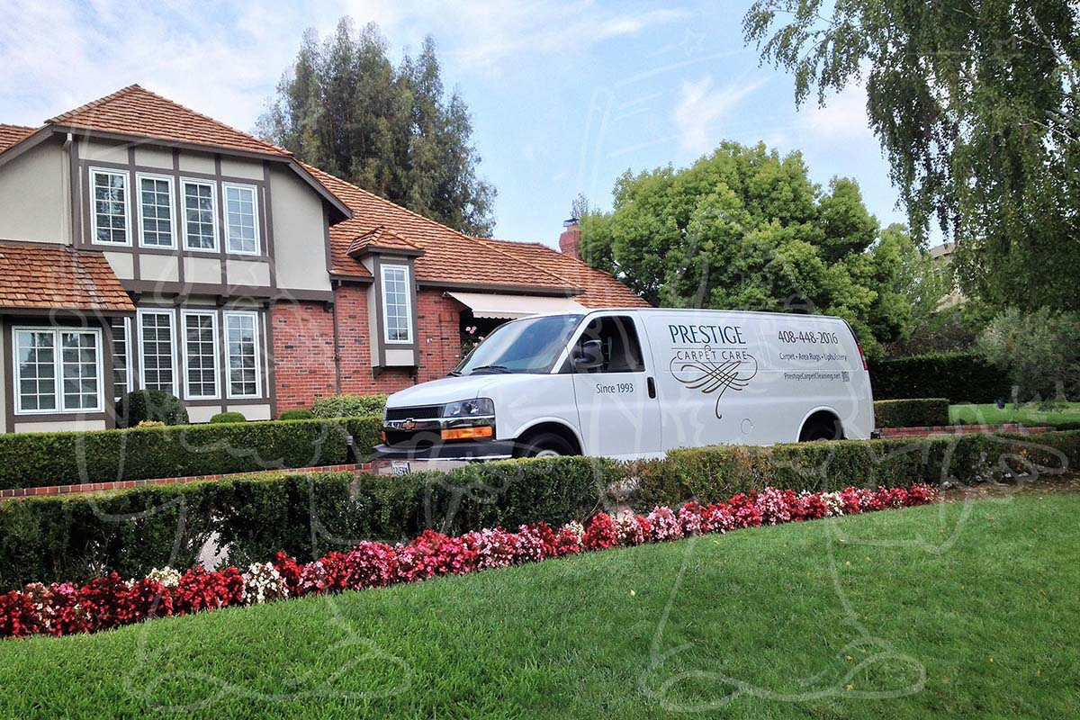 Carpet Cleaning Van Pulling Up at a Home Photo Example